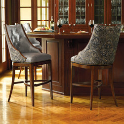 """Frontgate - Bradford Tufted Bar Stool - Handcrafted hardwood frame. 180-degree return swivel with lifetime guarantee. Brass-plated footrest. Nonmarring floor glides. Arrives assembled. Inspired by Regency design, Bradford has a refined, sloping profile and squared, tapered legs. The inside seat back is upholstered in full-grain leather with deep, diamond tufting. The upholstered back and curving, X-shaped stretcher look beautiful from behind.  . . . . . Diamond-tufted leather with fabric back. Inside depth: 17-3/4""""."""