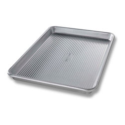 USA Pans Quarter Sheet Pan 13 x 9 Inch - The USA Pan Quarter Sheet Pan has been designed with many of the same standard features of industrial baking pans.  Each pan is constructed of aluminized steel  the material of choice for commercial bakeries.  Metal thicknesses have been selected that allow even heat distribution and maximum service life.  Our pans also use steel wires in the rim construction of most pans to provide additional strength and resist warping.  Each pan is coated with AMERICOAT© Plus  a proprietary silicone coating that nearly all North American bakers prefer over dark non-stick coatings.   AMERICOAT© Plus is a clear non-stick  environmentally friendly coating that is specifically formulated for superior baking and does not contain any PTFE̥s or PFOḀs.  USA Pan bakeware features a corrugated  or fluted  design.  The corrugation maximizes pan strength and prevents warping  denting and other effects of everyday use.  Corrugation also minimizes surface contact with baked goods which translates into an evenly baked product that is easily released. USA Pan has been developed by the world's largest manufacturer of industrial bakeware and has been providing the world's leading commercial bakeries with the highest quality baking pans for over 50 years.  When you purchase a USA Pan you are buying products that meet industrial standards for innovation  quality and durability.  Put simply  our pans are the best available and are proudly produced in the UNITED STATES OF AMERICA. Product Features                                   Constructed of heavy gauge aluminized steel             Corrugated design allows for even baking            Proprietary AMERICOAT© coating allows easy release of food            Proudly made in the USA for over 50 years