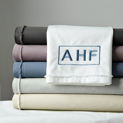 Organic Cotton Frayed-Edge Sheet Set - A subtle and uniform frayed edge of delicate voile creates an unexpected detail on this soft, organic cotton sheeting. A best-selling sheet set and a west elm green product.