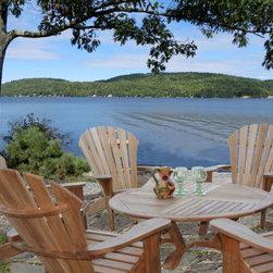 """Douglas Nance Atlantic Adirondack Chair - Excellent location for Douglas Nance teak furniture. Six Atlantic Adirondack Chairs fit perfectly around the Cayman 48"""" Conversation Table."""
