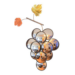 "Handmade by artist - Grape Mirror - Guarantee that guests will leave asking, ""Where on earth do you find such treasures?"" with this limited edition mirror art. The handmade grape cluster is actually a series of 12 convex mirrors arranged together to artfully convey your love of good design, three-dimensional pieces and, if so inclined, wine."