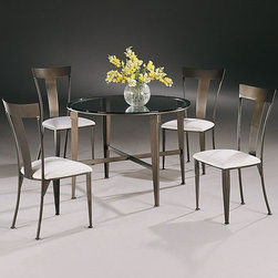 "Johnston Casuals - Geode 5 Piece Dining Set - Give your dining room a dramatic facelift with this stylish Geode Contemporary Dining Set. With ultra-sleek minimalist designs, solid powder-coat metal construction, and a 42"" round beveled-edge glass table top, this dining set is sure to modernize your dcor. And because each piece is individually hand-made in Johnston Casuals' USA factory, you can count on years of lasting quality and aesthetic appeal! Dining Set Features: -Dining set includes 1 dining table and 4 dining chairs. -Geode collection. -High-quality powder-coat metal construction. -42"" Round beveled-edge glass table top. -Commercial-grade welding. -Individually hand-crafted in the USA. -Ultra-sleek minimalist designs. -10-Year structural failure warranty on metal frames. Item Dimensions: -Dining Table: 30"" H x 42"" W x 42"" D. -Dining chair: 38"" H x 19"" W x 21"" D. More customization options may be available for an additional charge. Also, please be aware that as each item is created individually, slight variations in finish and shape may occur."