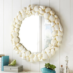 Shell Mirror - This is a classical coastal shell mirror at a great price. The off-white neutral color makes it work with any coastal-inspired decor.