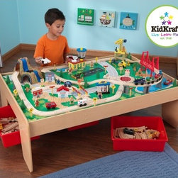 "KidKraft - Waterfall Mountain Train Set and Table - Learning while playing is fun with KidKrafts new wooden Train Table. It includes three bins and a 120 piece mountain train set. KidKrafts train table is kid-sized for hours of creative play. With a wide, generous play table, our train table has several unique features Features: -Sturdy wooden construction -Three Plastic slide-in storage bins -T-molded edges -Available in natural -Heat fused melamine sides -120 Mountain Train Set -Silk-screened landscaped playboard with reversible flip side -Train Table Dimensions: 17.5"" H x 49.25"" W x 35"" D -Playboard Dimensions: 32"" x 48"""