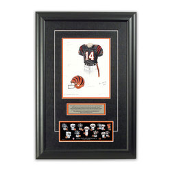 """Heritage Sports Art - Original art of the NFL 2001 Cincinnati Bengals uniform - This beautifully framed piece features an original piece of watercolor artwork glass-framed in an attractive two inch wide black resin frame with a double mat. The outer dimensions of the framed piece are approximately 17"""" wide x 24.5"""" high, although the exact size will vary according to the size of the original piece of art. At the core of the framed piece is the actual piece of original artwork as painted by the artist on textured 100% rag, water-marked watercolor paper. In many cases the original artwork has handwritten notes in pencil from the artist. Simply put, this is beautiful, one-of-a-kind artwork. The outer mat is a rich textured black acid-free mat with a decorative inset white v-groove, while the inner mat is a complimentary colored acid-free mat reflecting one of the team's primary colors. The image of this framed piece shows the mat color that we use (Orange). Beneath the artwork is a silver plate with black text describing the original artwork. The text for this piece will read: This original, one-of-a-kind watercolor painting of the 2001 Cincinnati Bengals uniform is the original artwork that was used in the creation of this Cincinnati Bengals uniform evolution print and tens of thousands of other Cincinnati Bengals products that have been sold across North America. This original piece of art was painted by artist Bill Band for Maple Leaf Productions Ltd. Beneath the silver plate is a 3"""" x 9"""" reproduction of a well known, best-selling print that celebrates the history of the team. The print beautifully illustrates the chronological evolution of the team's uniform and shows you how the original art was used in the creation of this print. If you look closely, you will see that the print features the actual artwork being offered for sale. The piece is framed with an extremely high quality framing glass. We have used this glass style for many years with excellent results. We"""