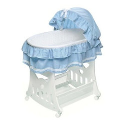 Badger Basket Blue Waffle Portable Bassinet n Cradle with Toybox Base - The perfect first bed for your baby, the Badger Basket Blue Waffle Portable Bassinet n Cradle with Toy Box Base easily converts to a toy box when your baby has outgrown the bassinet. Designed for babies up to 20 lbs., you can use this bassinet until your infant begins to push up or roll over unassisted. Featuring a mesh basket, you can store diapers, wipes, burp cloths, and other necessary items so you're never stumbling about in the middle of the night. You can also lift the bassinet off its base so you can keep your baby by your side wherever you are (never carry the bassinet with your baby inside). Castor wheels makes it easy to move this bassinet from room to room (again, not with baby inside), or you can flip up the wheels and convert it to a rocking bassinet making it easier to soothe your to sleep. Complete with a blue ruffled and quilted liner, floor-length skirt, adjustable canopy, fitted sheet, and mattress pad, the bassinet has everything you need for your baby's arrival. The mattress pad is covered in vinyl for easy cleaning, and the bedding is also machine-washable. Some assembly is required.Additional FeaturesBaby blue ruffled greed linerCaster wheels makes moving bassinet simpleConverts to a rocking cradleQuilted liner, skirt, canopy, sheet, and pad includedAdjustable canopyVinyl covered pad is easy to cleanBedding is machine washableIllustrated instructions includedSome assembly requiredBadger Basket CompanyFor over 65 years, Badger Basket Company has been a premier manufacturer of baskets, bassinets, bassinet bedding, changing tables, doll furniture, hampers, toy boxes, and more for infants, babies, and children. Badger Basket Company creates beautiful and comfortable products that are continually updated and refreshed, bringing you exciting new styles and fashions that complement the nostalgic and traditional products in the Badger Basket line.