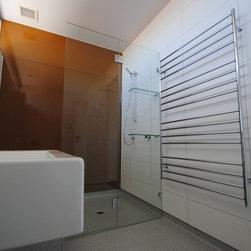 "Frameless Shower Enclosures - Smaller bathroom featuring a frameless operating splash panel.  glass shower door. and glass shelving is 3/8"" standard clear glass."