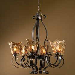 """Uttermost - Vetraio 6-Light Chandelier by Uttermost - Taking its name from the Italian word for """"glazier,"""" the importance of hand-made glass is evident in the Uttermost Vetraio 6-Light Chandelier. Designed by Carolyn Kinder, its most glowing and unique feature is the heavy, hand-made Toffee Art glass shades. The iron frame is similarly impressive, its curvaceous and strong form enhanced by a deep Oil Rubbed Bronze finish.Since 1975, Uttermost has made it their mission to make great home accessories at a reasonable price. From their headquarters in Rocky Mount, Virginia, Uttermost continues to meet this goal with sophistication and grace through their current line of quality, designer-driven lighting, home furnishings and accessories.The Uttermost Vetraio 6-Light Chandelier is available with the following:Details:6 hand-made Toffee Art glass shadesIron frameOil Rubbed Bronze finishCeiling canopy5' chainDesigned by Carolyn KinderLighting:Six 60 Watt 120 Volt Candelabra Base Incandescent lamps (not included).Shipping:This item usually ships within five business days."""