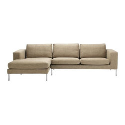 Bensen - Neo Sectional with Chaise - If you ask Niels Bendtsen why his Neo Collection is just as relevant today as when he first designed it, he'll point out its proportions, which are something he's developed and perfected over time. In the 1960s, Bendtsen was importing Scandinavian furniture, but began designing his own when he couldn't find the quality and aesthetics he wanted. Neo is a culmination of Bendtsen's experiences as an importer and designer. The frame is hand-built and draws on techniques Bendtsen learned from his father, who also designed furniture. The foam seat cushions are sourced from Italy because he hasn't found any others that offer his ideal mix of firm support and comfort. And the removable cushion covers make Neo an easy-to-live-with collection. Bendtsen's work is in the permanent collection of MoMA, and he was honored with the 2006 British Columbia Creative Achievement Award of Distinction. Made in Canada. Due to the size and weight of this item, we recommend our White Glove delivery service. Please review our shipping options. During checkout you will select the option that best fits your needs.