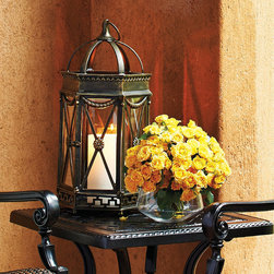"Frontgate - Avalon Outdoor Lantern - Frontgate exclusive. Ideal accent lighting for a side table or on the ground next to a furniture collection. Powdercoating protects against the elements. Holds three 3"" dia. candles. Decorative circular loop handle at top enables easy movement. Outdoor lighting gains a refined accent when candles gleam through this gorgeously detailed Avalon Lantern. Durable powdercoated aluminum is hand-painted and given gold highlights. Double-door opening makes it easy to insert candles, light and clean.. . . . . Suitable for outdoor or indoor use. Wipe clean with a soft, damp cloth."