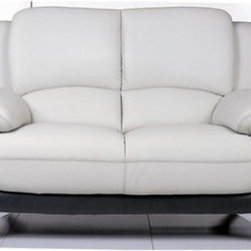 117 Leather Loveseat - Tan/Black - The 117 Leather Loveseat - Tan/Black invites you and a friend to settle into cool luxury. As comfortable as it is handsome, this loveseat is loaded with plush cushions, from the seat back to the arms and sides. Its two-tone black and tan leather is top-grain and smooth to the touch. Arched, polished chrome legs provide support and style. This loveseat features a kiln-dried, solid wood frame, pocket coil core, and foam cushions that make it a comfy seat for two.About Beverly Hills Furniture, Inc.Beverly Hills Furniture, Inc. is a modern furniture company headquartered in New Jersey. They are a premier purveyor of contemporary furniture with a passion for the very finest designs and quality. Beverly Hills Furniture specializes in providing quality home furnishings, cases, and accessories.