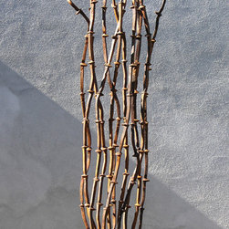 Home & Garden - Made of authentic railroad spikes, this original sculpture takes no care. Just enjoy its simple, flowing lines and height in a compact space.