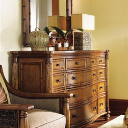 Tommy Bahama Home - Triple Dresser Set - Decor accents not included. Includes mirror and a triple dresser. Warranty: 1 year limited. Made from maple veneers, select hardwood solids and glass. Plantation - Lightly distressed warm umber finishMirror:. Carved wood frame. Woven cane on the frame. Can be used vertically and horizontally. Plate: 37 in. W x 27 in. H. Overall: 47 in. W x 37 in. HTriple Dresser:. Thirteen drawers. Drawers are constructed using English dovetails. Wood runner and guides. Drawer stop. Tommy Bahama drawer plaque. Leather wrapped carved wood posts. Serpentine front. Custom designed with basket weave knobs and recessed pulls in an antique brass finish. 32 in. W x 20 in. D x 30 in. H. Overall Weight: 299 lbs.. Special Care InstructionsIsland Estate lends inspiration to tropical design through a rich blending of natural materials, textures and exciting new finish colors. Designs for the whole home encompass an eclectic mix of British Plantation and refined Caribbean styling, with a playful dose of exotic island fun. Wherever the locale, Island Estate embodies a lifestyles that is elegant and refined, yet casual and cool. The essence of Tommy Bahama Home is a relaxed approach to the fine things in life.