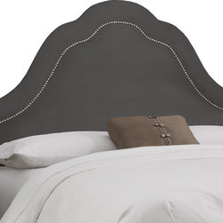 None - Made to Order High Arch Charcoal Headboard with Nails - This classic high arch style headboard is upholstered in sleek microsuede and embellished with a row of decorative nail buttons inset from the silhouette. It's dramatic design is sure to make it a focal centerpiece of any bedroom.