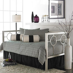 Leggett & Platt - Astoria Daybed Multicolor - RN478 - Shop for Daybeds from Hayneedle.com! Update your space wit the Astoria Daybed. With a sleek silver finish and hip geometric design this daybed will ramp up the contemporary edge of any space. The straight and sturdy metal frame is offset by interior circles to deliver a clean polished appearance. Link spring mattress support is included with daybed purchase. Your choice of roll-out or pop-up trundle is available for extra sleeping accommodations. A trundle is an extra mattress frame stored beneath a daybed which slides out to provide additional sleeping space when needed. The optional trundle packages include your choice of a metal roll-out trundle frame or a metal pop-up trundle frame. The roll-out frame remains low to the ground as an additional twin-sized bed. The pop-up trundle can be left in the lowered position or elevated in the pop-up position to align with the primary daybed mattress. The pop-up feature allows the daybed to transform from a twin-size daybed into a king-size bed. About Fashion Bed GroupFashion Bed Group is a Leggett and Platt Company known for its innovative fashion beds daybeds futons bunk beds bed frames and bedding support. Created in 1991 Fashion Bed Group is a large consolidation of three leading bed manufacturers. Its beds are manufactured of genuine brass plated brass cast zinc cast aluminum steel iron wood wicker and rattan. Fashion Bed Group's products are distributed throughout North America from warehouses located in Chicago Los Angeles Houston Toronto and Ennis Texas.