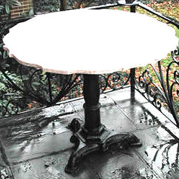 "Garden Table - Cast iron base with a scalloped edged stone top. 30""H x 38""W"