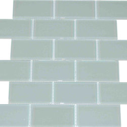 "Spa Glass - Light Gray 2X4 Subway Glass Tile, Light Gray, 2x4, Carton - CARTON of Light Gray 2X4 subway glass tile consisting of 20 square feet or sheets. This tile is manufactured in a thinner 1/8 inch thick format and is a high quality ""POOL RATED"" glass subway tile that is perfect for a kitchen backsplash, bathroom tile, shower tile or pool tile. Because the tiles are thinner and come mesh mounted in a staggered interlocking brick pattern, installation is much easier and much less expensive. The thinner profile eliminates the need for tear outs or large demolitions. You can tile over existing materials and eliminate installation cost ( think DIY).These are a very high grade glass subway tile kilned at 800 Celsius for maximum durability and come with a baked polypropylene backing which reflects the color back thru a very clear glass.  The tiles come in a 12X12 inch sheet consisting of 18 tiles 2X4 inches in size.  They come in boxes of 20 square feet or 20 sheets. There is also a SAMPLE option so you can confirm the color is perfect for your space. The Price listed is for a single CARTON OF 20 SQUARE FEET."