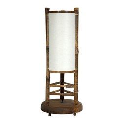 "Oriental Furniture - 20"" Koru Japanese Bamboo Table Lamp - This table lamp is the smallest of our Koru design series, a particularly appealing hand crafted, rustic design. Made from all natural materials, whole bamboo, solid wood, and pressed pulp rice paper, it could be a candle lantern or oil lamp from the time of the famous Japanese Samurai warriors. However, the Edo period Shogun didn't require UL approved wiring, power cords, wheel switches, and American size light bulb sockets. If you find that rustic, tropical, and natural looking materials appeal to you, than this Koru lantern may be a great lamp for your home. Also, they cast beautiful, soft, warm, diffused light through out the rooms where they're placed."
