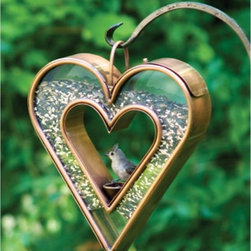 Good Directions - Good Directions Heart Fly-Thru Bird Feeder - 113VB - Shop for Feeders from Hayneedle.com! Tell the birds how you really feel with the Good Directions Heart Fly-Thru Bird Feeder. We know you love them so let them know with a sturdy fly-thru feeder with plenty of food storage and style.About Good DirectionsGood Directions got its start by creating weathervanes and cupolas but it has expanded its line to include a wide range of decorative yet functional products for the home and garden including popular Fire Domes rain chains and garden weathervanes. The company continues to attract innovative artists and designers eager to lend their vision to the creation of exceptional products to enhance the home both indoors and out. No matter which way the wind blows you can count on Good Directions to show you the way to a beautiful home.