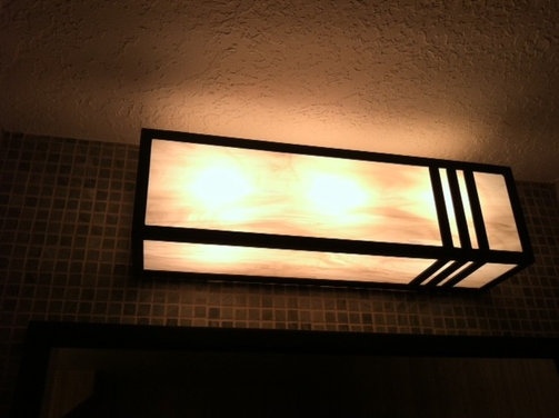 Bathroom Vanity Light Bar with Large Globes--can I cover them?