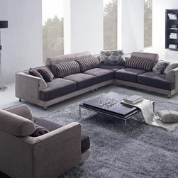 Fabric Sofa - High style and good living has never been better with this two tone beige and brown sectional sofa. It brings the traditional styling elements together to form an updated new look for your living room or den. This collection has it all: contrasting solid fabric colors, stripes, patterns and it all comes together to present a sophisticated look with all the classic elements anyone can appreciate. It includes a one seater, two seater and a four seater, along with one oversized pillow and four smaller throw pillows. A beautiful choice and its quality ensures it stays that way.