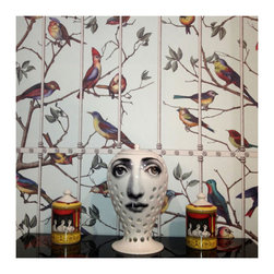 Cole & Son - Fornasetti II Uccelli Wallpaper - Cole & Son's new collection follows the success of the first Fornasetti Collection, launched in 2008, delivering a repertoire of magical themes within a collection of designs that are at once iconic and covetable. Fornasetti II takes a bold step in wallpaper design, transcending the obvious and transforming eclectic and whimsical drawings into a truly stunning array of co-ordinating wallpapers in an exciting range of colors and styles. Eccentric motifs of fantastical flying machines, architectural details, playful monkeys, keys and owls all evoke a theatrical and magical space, while the use of wide width friezes, borders, digital panels and double width papers gives this collection an unparalleled diversity in the way in which it can be used. Welcome to the magic of Fornasetti's World!