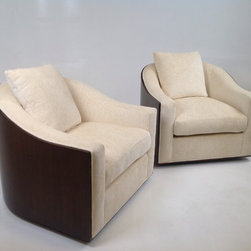 Milo - Walnut paneled lounge chairs done in a off white chenille.