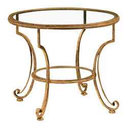 "Inviting Home - Round Glass Top Table - Round hand-wrought iron two tier table with distressed antiqued gold leaf finish 3/8"" glass top and shelf; 28-1/2"" x 23-3/4""H made in Italy Round hand-wrought iron two-tier table. Wrought iron table finished in distressed antique gold-leaf and has 3/8"" thick glass top. This hand-wrought iron table is hand-crafted in Italy."