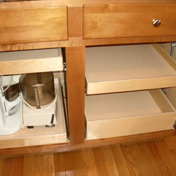 Creative Storage Solutions - Custom pull out shelves create a place for your kitchen appliances, keeping them off of your counters for an uncluttered look.  ShelfGenie of Portland pull out shelves hold up to 100 pounds when fully extended.