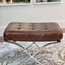 Leather & Chrome Ottoman - Cool and versatile, this ottoman is solidly made with polished steel legs and a hand wrapped leather deck that holds a sturdy button tufted, leather cushion.  Purchase a pair and pull them up to a coffee table or at the end of the bed.