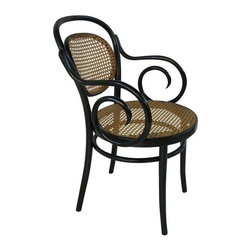 """Pre-owned Michael Thonet B6659 Bentwood Armchair - The Michael Thonet designed B6659 bentwood armchair is the armchair version of the popular A6658 side chair. This bentwood armchair uses a classic styled swirling arm, hand-woven cane seat, and elegant frame finished in black.    Original European Thonet factories in Radomsko Poland, and Brno, Czech Republic, using historic molds and techniques, manufactured these pieces. Remarkably few changes have been necessary over the last 150 years. The factories still follow the 18th century production methods developed by Michael Thonet to produce historically accurate, handsome, and sturdy bentwood chairs, stools, tables, and accessories. Cane seats are hand-tied, and wood laths steamed and bent into curved jigs then dried, sanded, and finally stained and varnished before being assembled.     They were featured in House Beautiful's design trend section: """"Everywhere We Look.""""    Seat height 18 1/4"""" Seat diameter 19"""" Arm height 26 3/4""""    Check out the seller's other listings for a set of 4 Thonet side chairs that are this same style."""