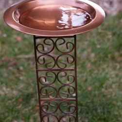 Classic Copper Bird Bath Bowl with Jalousie Stake - Additional FeaturesStake features an antique finishStake measures 6.5W x 34.5H inches The beautifully decorative Classic Bird Bath Bowl with Jalousie Stake features a jalousie stake with intricate scroll work that adds an elegant touch. Crafted from solid copper for longevity the warm antique copper finish looks gorgeous in any yard or garden. The 3-inch basin is perfect for water or food and you'll love spending hours watching birds fly to and from your yard.