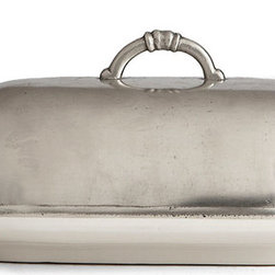 Tuscan Butter Dish - Ceramic dishes with pewter covers populate the tables of sidewalk cafes in the Europe you imagine when you catch sight of a photographed vista or city street map. Perfectly combining a sleek, no-nonsense sensibility with a note of artisan romance, the Tuscan Butter Dish keeps a classic condiment fresh on the table beneath a cover of silky grey pewter.