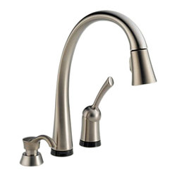 Delta - Delta 980T-SSSD-DST Pilar 1-Handle Pull-Down Faucet w/Soap Dispenser (Stainless) - The Delta 980T-SSSD-DST is a Pilar style single handle pull-down kitchen faucet with soap dispenser that comes in a beautiful, stainless steel finish, making it a bright addition to any 3 or 4-hole mount kitchen sink. It comes with a convenient soap dispenser, making your sink that much more accessable. The pull-down spout makes quick work of any larger sink or awkard sized dish messes, and features a Touch2O sprayhead that makes it activate at the touch of the spout. The faucet also features a single lever handle that makes adjusting the temperature of your water easy. This faucet set comes with a Lifetime Faucet and Finish Limited Warranty to the original consumer purchaser to be free from defects in material and workmanship, and a 5-year Limited Warranty for usage in all industrial, commercial, and business applications.