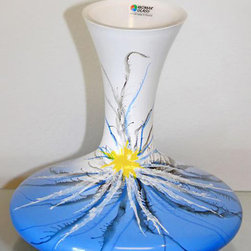 None - Blue Desert Flower Glass Vase - This Desert Flower vase features hand-formed and hand-painted construction. This decorative blue vase has an eye-catching flower on the front and is the perfect finishing touch for any room.