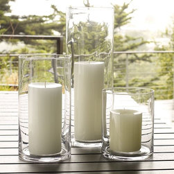 Simple Hurricane - A simple hurricane is a must have. You can fill them during the holidays with pretty glass balls or cranberries for an organic feel, or simple candles for an everyday clean and pretty look.