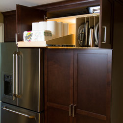 Sloped Pull Out Shelf and Tray Dividers - The sloped pull out shelf keeps items secure with the extra height provided in the back of the shelf, ideal for those upper cabinets.  The tray dividers allows for easy retrieval of your flat items like cookie sheets and cutting boards.