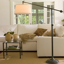 "Chelsea Sectional Lamp with Linen/Cotton Shade, Bronze finish - Brighten a spacious seating area with this handsome lamp. 51"" wide x 19.5"" deep x 66"" high; extends to 79.5"" high Cast of steel and aluminum alloy. Slender boom arm floats light over a couch or sectional without impeding movement. Ball-shaped counterweight makes it easy to adjust with a touch; head pivots to direct the light. Choice of burlap or linen-cotton shade is included and fitted with a diffuser to filter the light. Full-range dimmer switch. Title 20 compliant lamps will be shipped to CA addresses. {{link path='pages/popups/california_code_popup.html' class='popup' width='480' height='300'}}Learn more{{/link}} to understand product differences. UL-listed."