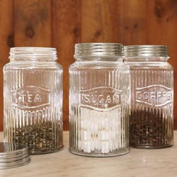 Vintage Pressed Glass Jars - Everyone needs a sweeter countertop storage idea, and these vintage, pressed-glass jars are perfect for teas, sugar and coffee.