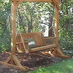 Wood Country 4-ft. Yardswing Stand with Optional Swing - This heavy duty porch swing stand is designed for years of safe reliable swinging. It's the perfect solution for someone who wants to put their porch swing out in the yard or on an uncovered deck. Purchase the stand by itself or as a set with your choice of our Cabbage Hill Ginko Leaf or Wine Country swings. The Cabbage Hill swing is featured in the picture above. The stand is built using the finest kiln-dried Western Red Cedar available. Guaranteed not to shrink or warp Cedar has a longer lifespan than oak or pine Uses full 2 x 4 and 4 x 4 cedar lumber Stand has a weight capacity of 600 lbs. About Wood CountryFine handcrafted outdoor furnishings are what Wood Country is all about. They manufacture a complete line of outdoor furniture and accessories made of clear kiln-dried Western Red Cedar. Each piece is hand-crafted and finished with a high quality penetrating oil weather stain. Wood Country is about offering their customers choices allowing them to create their own custom environment perfectly suited to enjoy their leisure time. Customers can choose the styles they like based on family need budget or just personal tastes. Wood Country uses the best materials hardware fabric and finishes they can find. Quality materials combined with Wood Country's talent means you're getting some of the best outdoor furniture available in today's market.