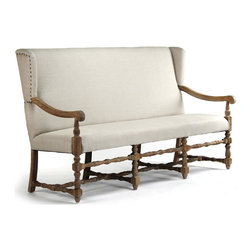 Kathy Kuo Home - Augusto French Country Linen Oak Dining Bench Sofa - They say the devil is in the details, but this natural linen dining bench sofa begs to differ. The divine is what you'll find when you look closely: nail head details on the wingbacks,  turned wood legs and framing and precise upholstery.  Whether placed within a living room or dining room setting, the style and craftsmanship of this beauty make for a heavenly effect.