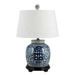 """Oriental Danny - Porcelain blue and white lamp - Classic design in blue and white. The chinese character """"Hei"""" means """"Double Happiness"""". Dress in silk lamp shade. 100 Watts, 3-way switch, UL listed."""