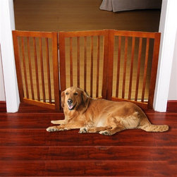 "54"" Wood Dog Gate 3 Panels - Folding Free Standing Pet Gate has a folding design that makes it simple to set up and store. The panels of the Folding Pet Gate fold to allow a range in length that accommodates a wide variety of doorways and openings. The elegant pine wood used for this product looks great in any room. The height of this pet gate is low enough to step over for ease of movement from room to room!  Please note: Some assembly required."