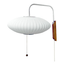 "Nelson - Nelson | Bubble Saucer Wall Sconce - Design by George Nelson, 1947.Made in the U.S.A. by Modernica.Ball lamp wall sconce. Plug-in cord, on/off switch on the socket. Arm extends 20"" from wall. 12 feet of cord with plug. Solid walnut backplate."