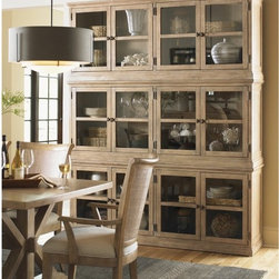 Lexington Home Brands - Lexington Home Brands Monterey Sands Sausalito Glass Door Stacking Unit Multicol - Shop for Buffets and Side Boards from Hayneedle.com! Create a gorgeous focal point in your home with the stunning Sausalito Glass Door Stacking Unit. Glass paneling across the front allows you to display your favorite books and items and the stackable design allows you to stack as many units as you need or to mix and match different units to create a unique look. Crafted from gorgeous Grey Elm veneer that's been gently wire-brushed to highlight its grain lines and then finished in a sandy brown accented by an oyster white glaze. Four doors open up to four adjustable shelves which gives you plenty of storage and display options. Grommets on the back gives you a place to thread cords so you can store electronics without creating a mess. Beautiful custom metal hardware accents the wood grain and the understated style of the West Coast which inspired this piece. Clean lines and elegant simplicity showcase the transitional design which complements almost any decor. Please note: this purchase is for 1 unit the main image shows 3 units stacked. Additional Features Beautiful custom metal hardware accents wood grain Gorgeous paneling is ideal for displaying items Grommets for cords in the back Gorgeous wood construction Blends natural materials and light wood tones Inspired by the understated style of the West Coast Clean lines and elegant simplicity Gorgeous transitional design About Lexington Home Brands Founded in 1903 in High Point NC Lexington Home Brands has become a globally known manufacturer and marketer of unique home furnishings. They are an industry leader in design style and quality products. Their product line consists of upholstered and hardwood furniture under recognized brands such as Lexington Tommy Bahama Sligh and Henry Link Trading Co.. Lexington Home Brand's intentions and aspirations are to create exclusive designs and styles that accommodate the 