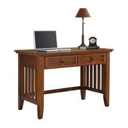 Home Styles Arts and Crafts Student Desk - Cottage Oak - With traditional Mission styling, this elegant desk has aesthetic details, like lattice moldings and gently flared legs. The Home Styles Arts and Crafts Student Desk - Cottage Oak is made of oak solids and oak veneers for durability. It has two framed drawers, with raised wood, that provide ample space for keeping various belongings. Besides a multi-step finish, this student desk has black finished hardware for enhanced visual appeal.