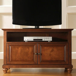 """Crosley - Cambridge 42"""" TV Stand - Enhance your living space with one of Crosley's impeccably-crafted TV stands. This signature cabinet accommodates most 42'' flat panel TVs and is handsomely proportioned featuring character-rich details sure to impress. Raised panel doors strategically conceal stacks of CDs/DVDs, gaming components and various media paraphernalia. Open storage area generously houses media players and the like. Adjustable shelving offers an abundance of versatility to effortlessly organize by design, while cord management systems tame the unsightly mess of tangled wires. Customize our distinct cabinets by selecting one of four collection styles (featuring tapered, traditional, turned or bun feet). This customizable cabinet approach is designed for easy assembly, built to ship and constructed to last. Features: -Raised panel doors.-Adjustable interior shelf for storing electronic components, gaming consoles, DVDs and other items.-Adjustable levelers in legs.-Recommended TV Type: Flat screen.-TV Size Accommodated: 42"""".-Powder Coated Finish: No.-Gloss Finish: No.-Material: Hardwood and veneers.-Solid Wood Construction: No.-Distressed: No.-Exterior Shelves: Yes -Number of Exterior Shelves: 1.-Adjustable Exterior Shelves: No..-Drawers: No.-Cabinets: Yes -Number of Cabinets: 1.-Number of Doors: 2.-Door Attachment Detail: Pin hinge.-Interchangeable Panels: No.-Magnetic Door Catches: Yes.-Cabinet Handle Design: Knob.-Number of Interior Shelves: 1.-Adjustable Interior Shelves: Yes..-Scratch Resistant : No.-Removable Back Panel: No.-Hardware Finish (Finish: Black): Brushed nickel knobs, steel hardware.-Hardware Finish (Finish: Classic Cherry, Vintage Mahogany): Antique brass knobs, steel hardware.-Casters: No.-Accommodates Fireplace: No.-Fireplace Included: No.-Lighted: No.-Media Player Storage: Yes.-Media Storage: No.-Cable Management: Hole in back for wires.-Remote Control Included: No.-Batteries Required: No.-Weight Capacity: 200 lbs.-Swatch Available: No.-"""