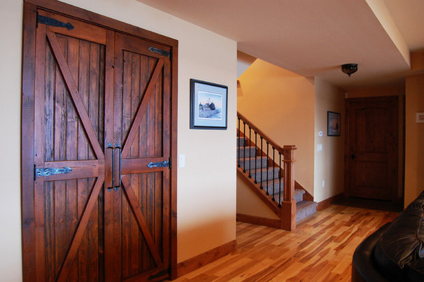 Traditional Basement by Traci Rauner Design