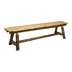 "Montana Woodworks - Montana Woodworks 6ft Plank Style Bench in Glacier Country - 6 feet - Montana Woodworks 6ft Plank Style Bench belongs to Glacier Country Collection by Montana Woodworks Similar to Montana Woodworks half log bench but without all the weight, this six foot long plank style bench is handcrafted from solid, American grown wood. The lodgepole pine logs rails and legs gives this bench that extra touch of rustic appeal and charm. Finished in the ""Glacier Country"" collection style for a truly unique, one-of-a-kind look reminiscent of the Grand Lodges of the Rockies, circa 1900. First we remove the outer bark while leaving the inner, cambium layer intact for texture and contrast. Then the finish is completed in an eight step, professional spraying process that applies stain and lacquer for a beautiful, long lasting finish. Comes fully assembled. 20-year limited warranty included at no additional charge. Bench (1)"