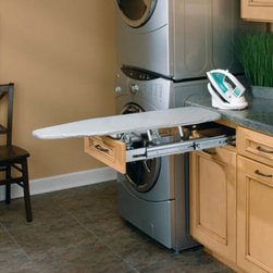 Ironing Solutions - An ironing board the folds into and pulls out of a standard drawer.